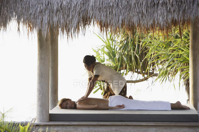 Woman receiving massage — Stock Photo
