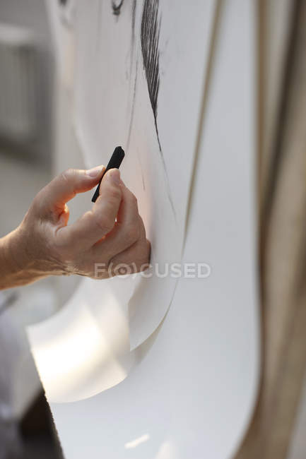 Hand working on painting — Stock Photo
