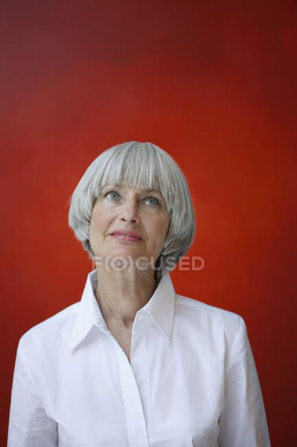 Woman standing in art studio — Stock Photo