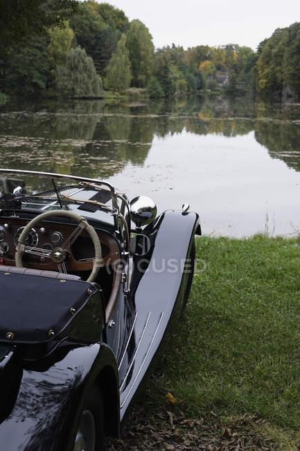 Car parked near lake — Stock Photo
