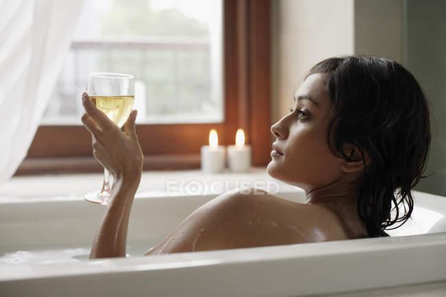 Woman laying in bathtub — Stock Photo