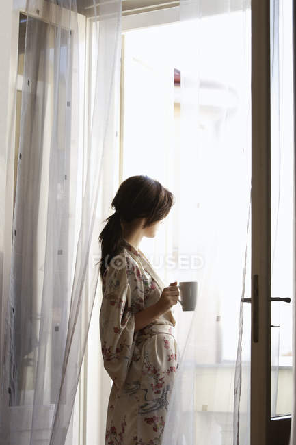 Woman having morning coffee — Stock Photo