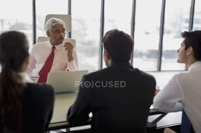 Businessman leading discussion — Stock Photo