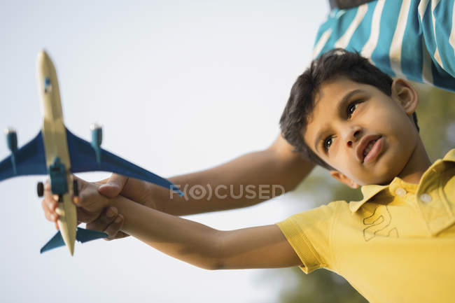 Boy playing with toy plane — Stock Photo