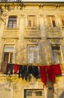 Line of laundry on old building — Stock Photo
