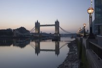 Tower Bridge reflected in the calm water — Stock Photo