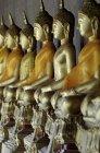Wat Arun, row of buddhas — Stock Photo