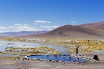 People in natural hot spring baths — Stock Photo