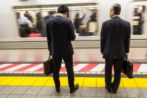 785-2031Two businessmen waiting for train — Stock Photo