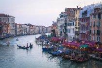 Gondola crossing Grand Canal — Stock Photo