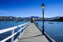 Long wooden pier in Akaroa — Stock Photo