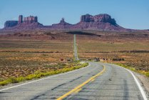 Long road leading to Monument Valley — Stock Photo