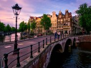 Sunset view of canal in Amsterdam — Stock Photo