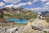 Clouds and sun on turquoise lakes — Stock Photo