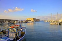 Boat in Venetian Harbour and Fortress — Stock Photo