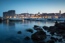 Lights of old town Dubrovnik and harbor — Stock Photo
