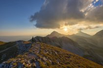 Child hiker in front of mountain Portella at sunset, Gran Sasso e Monti della Laga National Park, Abruzzo, Italy, Europe — Stock Photo
