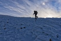 Hiker walking at sunrise in winter, Monte Cucco Park, Apennines, Umbria, Italy — Stock Photo
