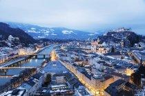 Illuminated old town and Hohensalzburg Castle at dusk, Salzburg, Austria — Stock Photo