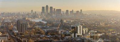 Misty Canary Wharf skyline at sunrise, Docklands, London, England, United Kingdom — Stock Photo