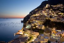 Sunset overlooking picturesque Positano on the Amalfi Coast, Campania, Italy — Stock Photo