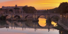 Arched Ponte Sant Angelo Bridge at sunrise, Tiber River, Rome, Lazio, Italy — Stock Photo