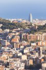Aerial view of residential buildings and Torre Agbar on background, Barcelona, Catalonia, Spain — Stock Photo