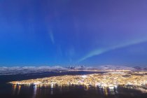 Northern Lights over city of Troms seen from Fjellheisen, Troms county, Norway, Scandinavia, Europe — Stock Photo