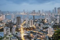 Skyline of illuminated downtown Cartagena city with modern apartment blocks at dusk, Colombia, South America — Stock Photo