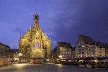 Illuminated of Frauenkirche on Main Market Square at dusk, Nuremberg, Bavaria, Germany, Europe — Stock Photo