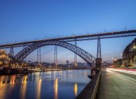 Illuminated Dom Luis I Bridge and Douro River at dusk, Porto, Portugal, Europe — Stock Photo