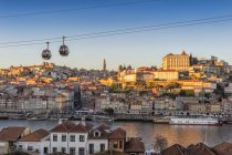 Sunset over Ribeira district and former Episcopal Palace, Porto, Portugal, Europe — Stock Photo