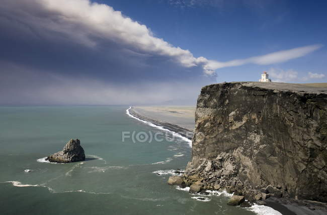 Headland with lighthouse at Dyrholaey — Stock Photo