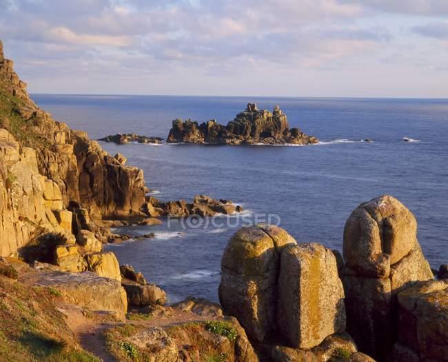 Rocky coastline with stones over water — Stock Photo