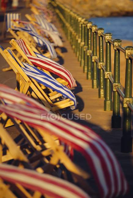 Windblown deckchairs on seafront — Stock Photo