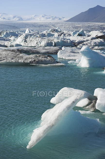 Icebergs melting in water lagoon — Stock Photo