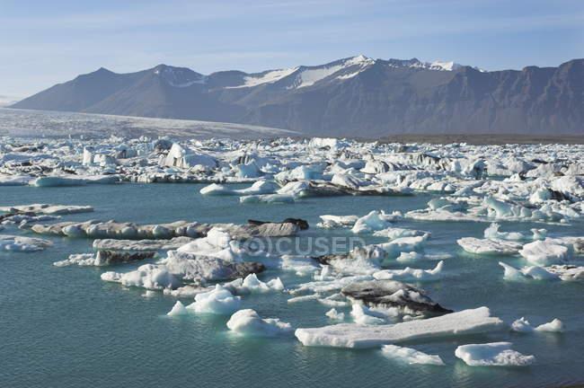 Icebergs melting in water lagoon — Stock Photo