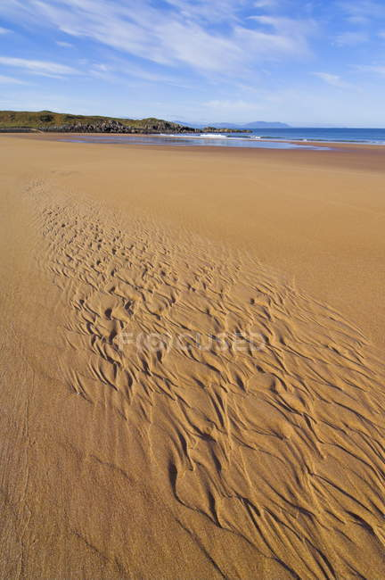Patterns in sand at Redpoint sandy beach — Stock Photo