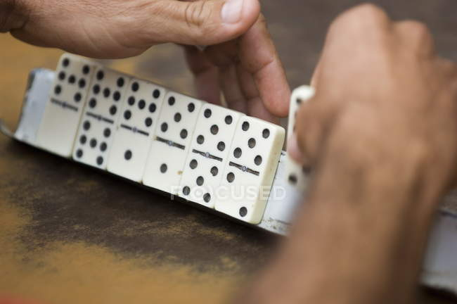 Man playing dominos — Stock Photo