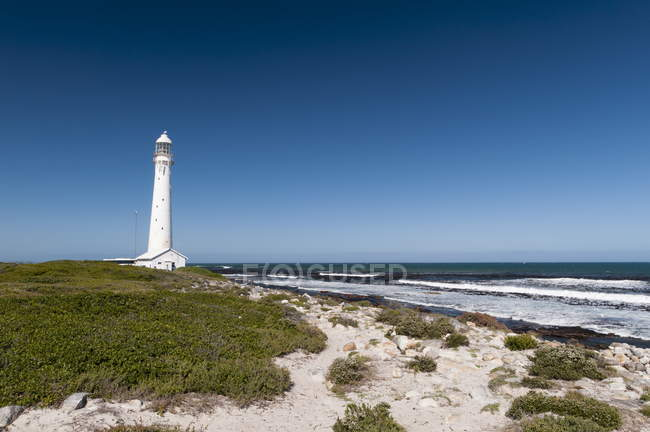 Slangkoppunt Lighthouse on shore — Stock Photo