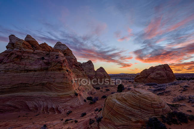 Orange clouds over sandstone cones — Stock Photo