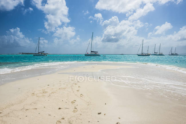 white sand bech in turquoise waters travel destination physical