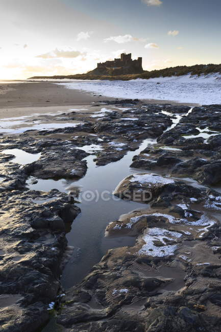 Snow on Bamburgh beach,  Bamburgh Castle — Stock Photo
