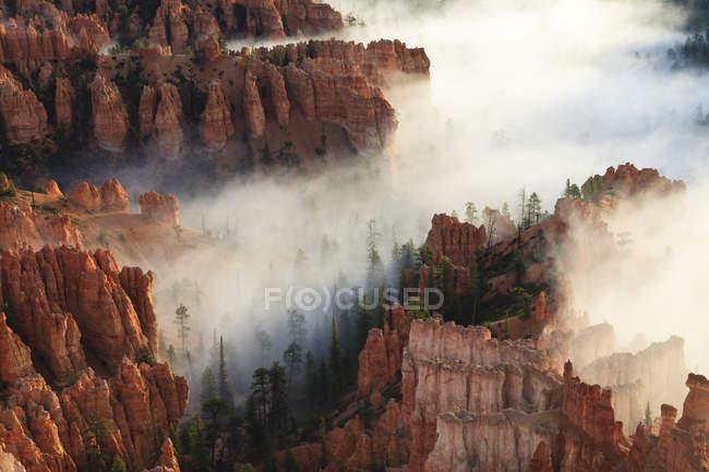 Pinnacles and hoodoos with fog — Stock Photo