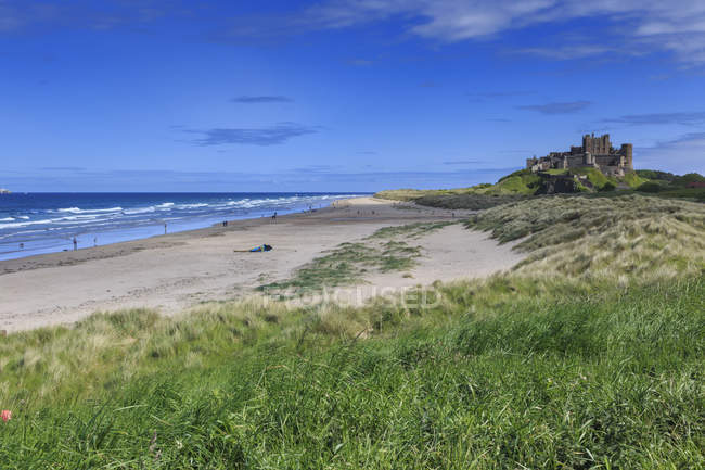 Bamburgh Castle across dunes — Stock Photo