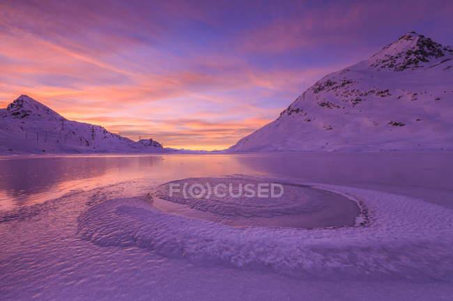 Lake Bianco at Bernina illuminated by light of sunrise — Stock Photo