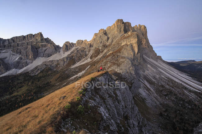 Hiker admires rocky peaks Furcella De Furcia — Stock Photo