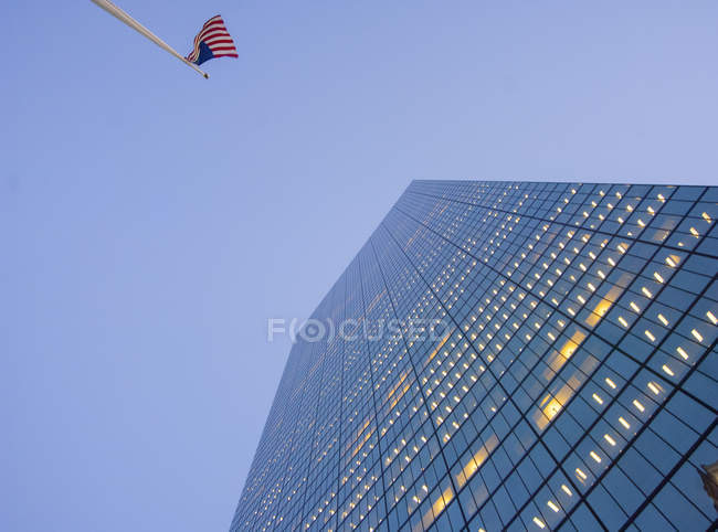 Boston skyscraper and USA flag — Stock Photo