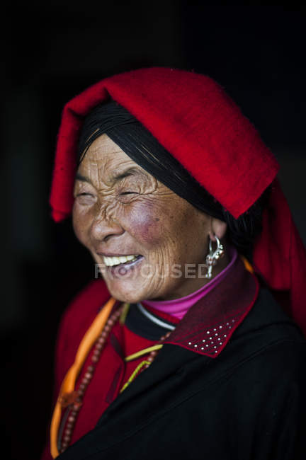 Chinese Ngawa woman in traditional dress — Stock Photo