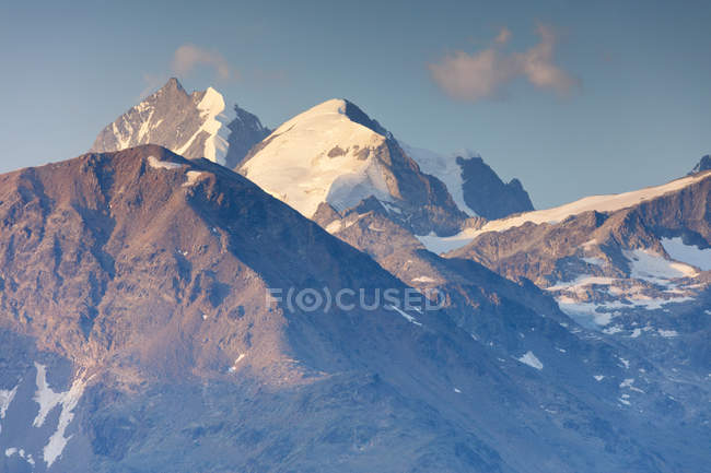 High peaks partially covered with snow — Stock Photo